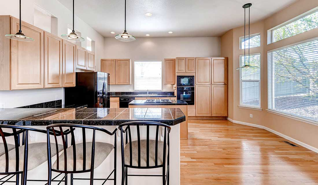 Open and Sunny Kitchen - Ranch Homes Castle Pines Co
